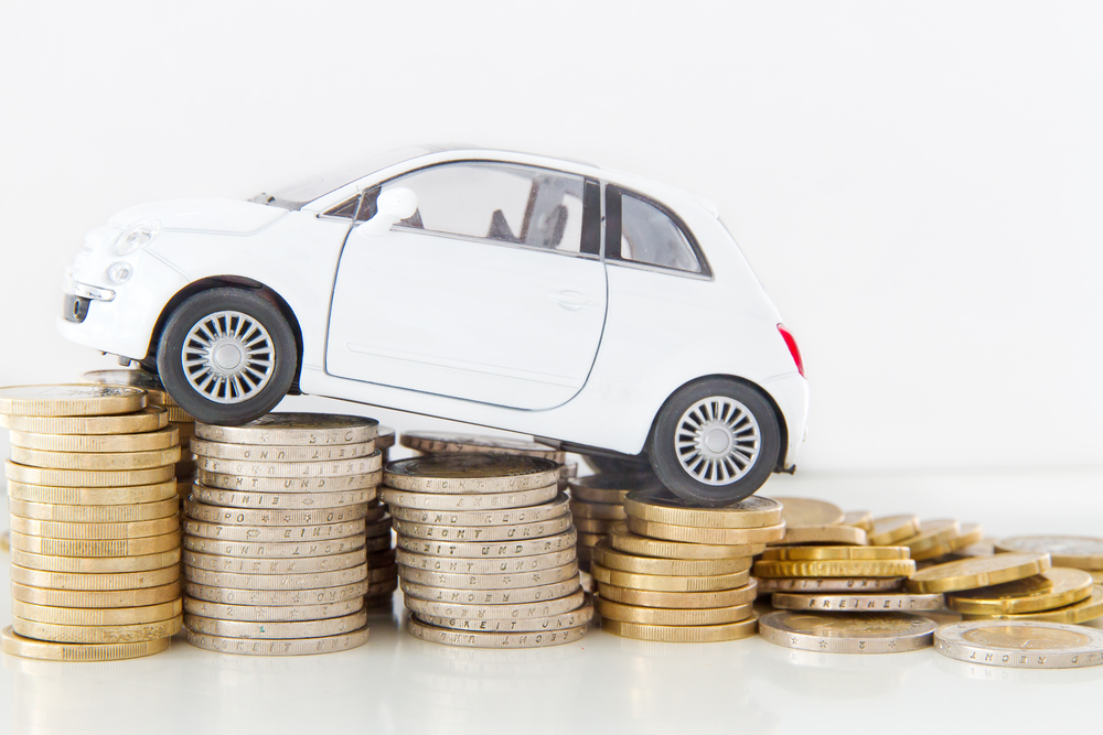 Tiny car climbs coin stacks