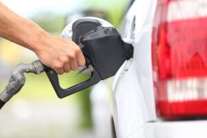 Man pumps gas at station