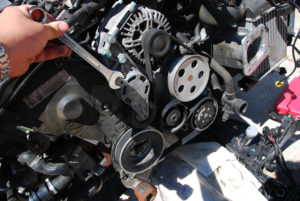 Man holding wrench in engine