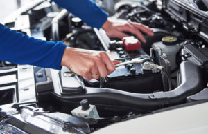 Mechanic repairing auto vehicle