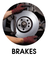 Image of hands around a car brake