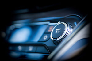 Air conditioning button to signify the role of air conditioning in auto repair